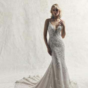 This sexy fit-and-flare wedding dress features swirls of pearls and beaded lace motifs atop tulle and textured netting.