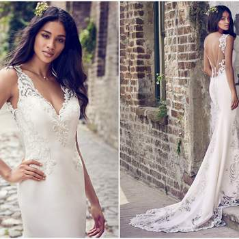"Embroidered lace motifs adorn the illusion cutout train, illusion scoop back, illusion straps, and illusion V-neckline in this Aldora Crepe sheath wedding dress. Finished with crystal buttons over zipper closure.   <a href=""https://www.maggiesottero.com/maggie-sottero/veronica/11198?utm_source=zankyou&amp;utm_medium=gowngallery"" target=""_blank"">Maggie Sottero</a>"