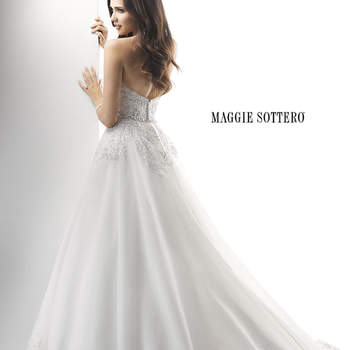 "Traditional elegance and timeless romance is found in this decadent ballgown. Embroidered sequin lace on tulle falls over a Venice Organza skirt, while a dazzling beaded waistband of Swarovski crystals adorns the waist. Finished with zipper closure.  <a href=""http://www.maggiesottero.com/dress.aspx?style=4MD848"" target=""_blank"">Maggie Sottero Platinum 2015</a>"