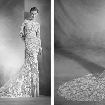 Atrevido y muy elegante. Un sugerente vestido de novia sirena realizado en tul y pedrería se funden en el cuerpo de la novia. El talle bajo y el escote barco con manga larga le aportan clase y mucha sensualidad. Sin duda, un diseño que enamora a primera vista.
