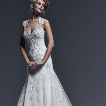 Bold lace appliqués, accented with sparkling Swarovski crystals, trail the length of this extravagant A-line wedding dress, complete with sweetheart neckline and dramatic illusion lace back. Finished with crystal button over zipper closure. <img height='0' width='0' alt='' src='http://ads.zankyou.com/mn8v' />