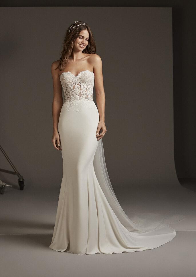 Vestido de novia corte sirena con encaje y cola en tul