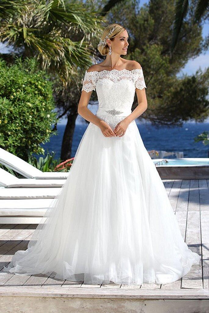 Feminin Braut- und Abendmode