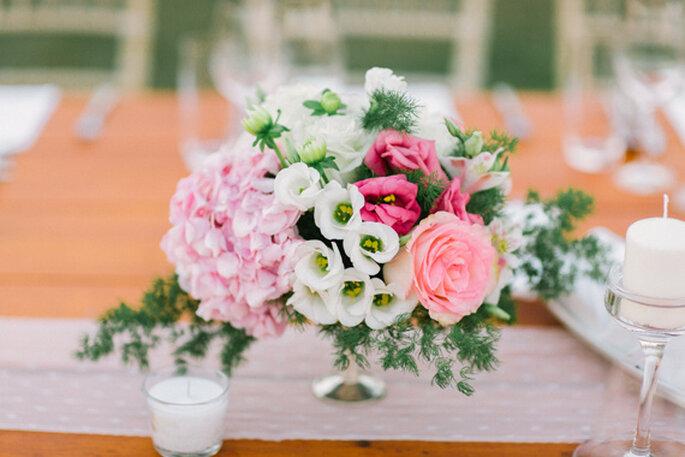 Majestuosos centros de mesas con grandes arreglos florales. Foto: André Teixeira de Branco Prata