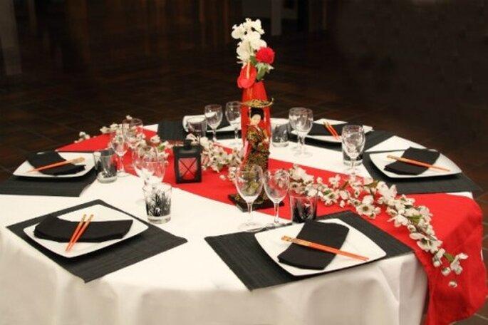 Une décoration de table adaptée aux saveurs : le petit détail choc. - Photo : Globe Traiteur