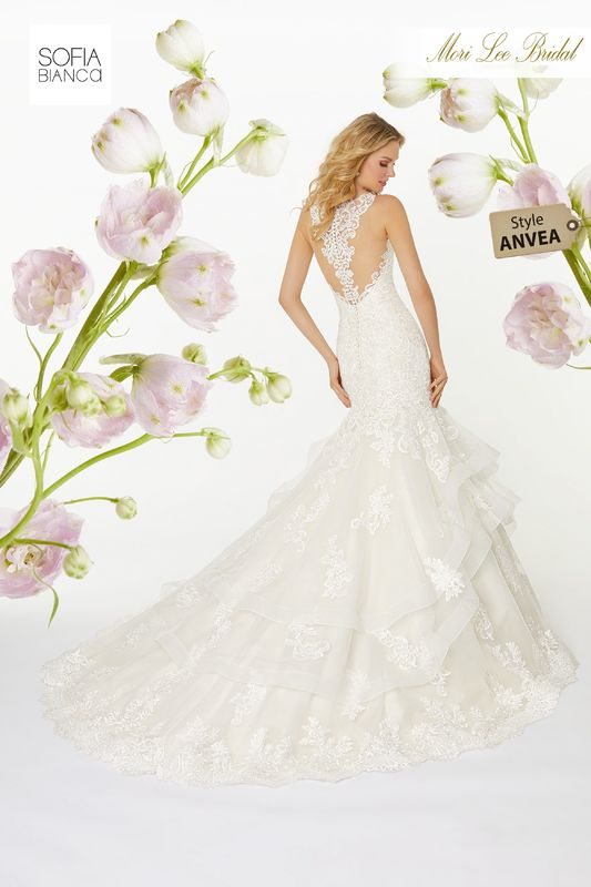Style ANVEA Simone  Embroidered appliqués on a horsehair edged, flounced tulle mermaid with wide hemlace