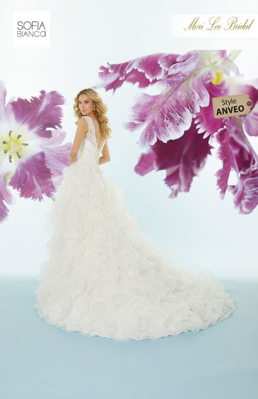 Style ANVEO Shakira  Crystal beaded venice lace appliqués over chantilly lace with flounced organza hi-low skirt