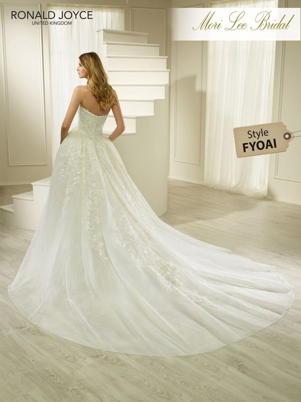 Style FYOAI HONESTY A STRAPLESS TULLE AND ORGANZA BALL GOWN WITH LACE APPLIQUES AND BUTTON BACK DETAIL. PICTURED IN IVORY.  COLOURS WHITE, IVORY