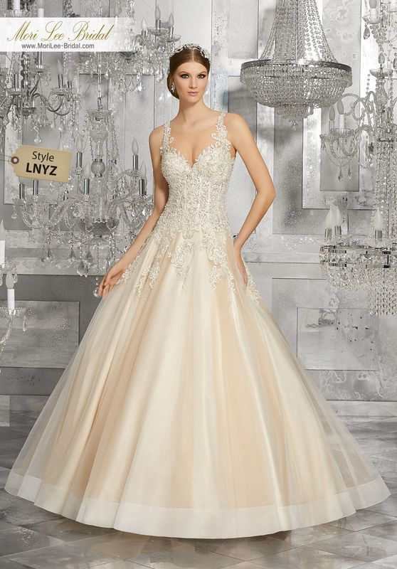 Style LNYZ Mahala Wedding Dress  Crystal Beaded Venice Lace Appliqués Accent the Sheer Neckline and Bodice of This Classic Bridal Beauty. Tulle Over Sparkle Net Adds Dimension to the Skirt. An Open Keyhole Back Completes the Look. Matching Satin Bodice Lining Included. Available in Three Lengths: 55″, 58″, 61″. Colors Available: White, Ivory, Ivory/Light Gold.
