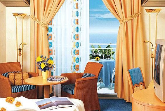 Beispiel: Zimmer, Foto: Travel Charme Kurhaus Sellin.