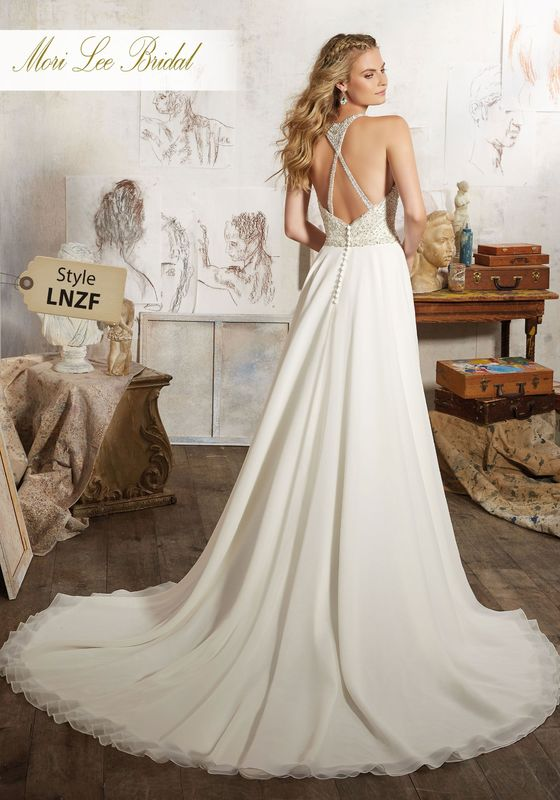 Dress style LNZF Maelani Wedding Dress Colors Available: White/Silver, Ivory/Silver.