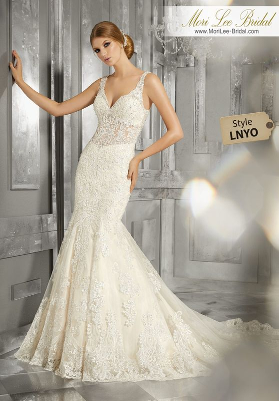 Style LNYO Maggie Wedding Dress  Sculptured, Embroidered Appliqués with Crystal Beading Accent the Sheer Bodice and Entire Silhouette on This Luxurious Fit and Flare Wedding Gown. A Wide Scalloped Hemline and Open Back Complete the Look. Matching Satin Bodice Lining Included -Available in Three Lengths: 55″, 58″, 61″. Colors Available: White, Ivory, Ivory/Light Gold.