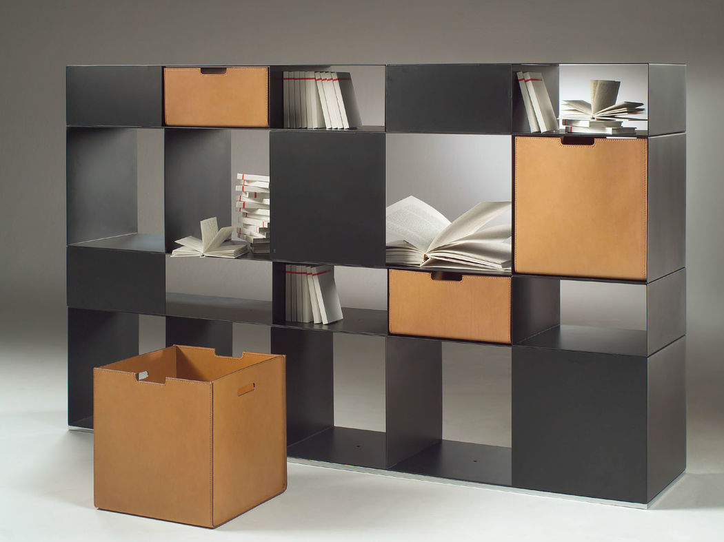 Infinity is a library system with enameled metal containers consisting of a few closed modules that are freely overlapped and joined together by a simple, invisible steel screw. These give rise to endless possibilities of composition and create a checkerboard game of empty volumes. Elegant and simple, it is extremely customizable.