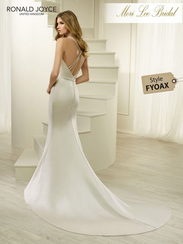 Style FYOAX HALONA A SATIN FIT AND FLARE DRESS WITH A BEADED V-NECKLINE, BEADED BELT DETAIL, CROSS OVER BACK STRAPS AND A DETACHABLE BOW DETAILED TRAIN. PICTURED IN OYSTER.  COLOURS WHITE, IVORY, OYSTER
