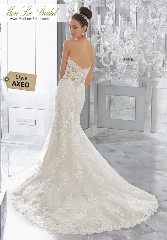 Style AXEO Marni Wedding Dress  Traditional with a Twist, This Soft Fit and Flare Wedding Dress Features Frosted Alençon Lace Appliqués Throughout the Sheet Boned Bodice Along to the Hemlace. Matching Satin Bodice Lining Included. Shown with Detachable Tulle Train (not included), Sold Separately as Style NXOEV. Available in Three Lengths: 55″, 58″, 61″. Colors Available: White, Ivory, Ivory/Light Gold.