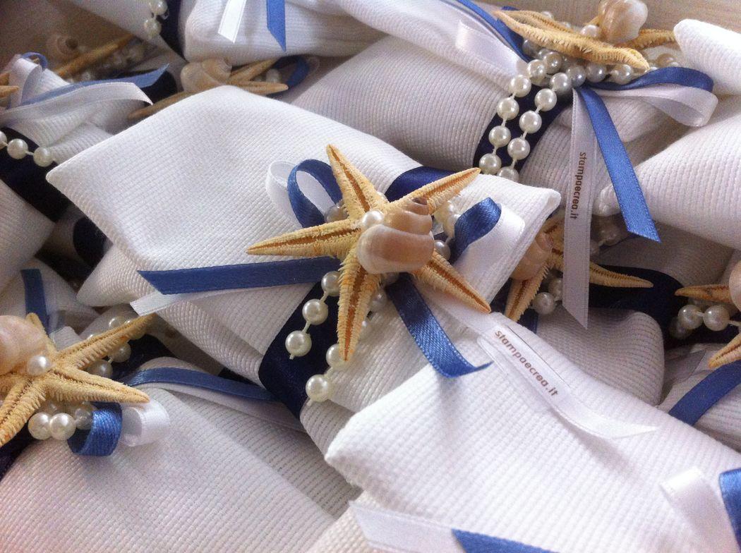 Sacchetto bomboniera in tela con stella marina per matrimonio a tema mare
