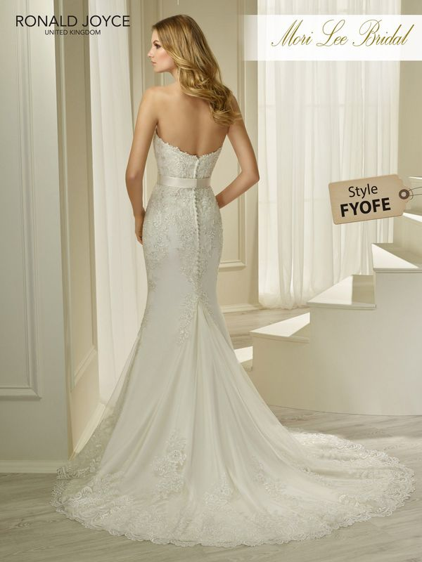 Style FYOFE HARLEE A STRAPLESS TULLE AND SOFT SATIN FIT AND FLARE DRESS WITH LACE MOTIFS AND A DETACHABLE BEADED BELT. PICTURED IN IVORY/SILVER.  AVAILABLE IN 3 LENGTHS: 55', 58' AND 61'   COLOURS IVORY/SILVER