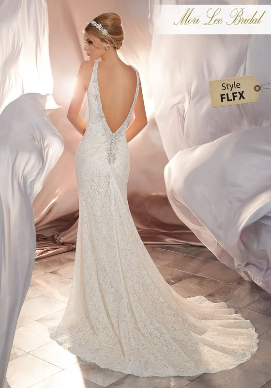 Style FLFX Mona Wedding Dress  Exquisite All Over Lace Accented with Diamanté and Crystal Beaded Shoulders Take This Romantic Bridal Gown to the Next Level. An open Deep-V Back with Covered Button Detail Completes the Look. Colors Available: White, Ivory, Ivory/Light Gold.