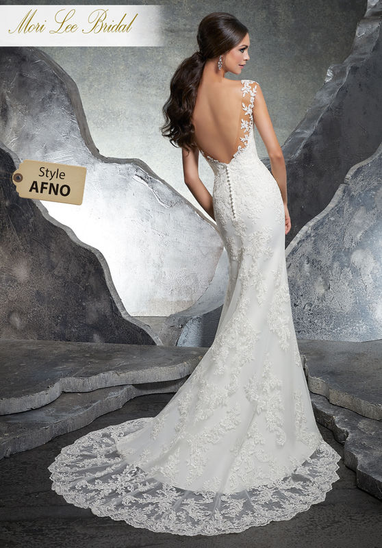 Style AFNO Kaylin Wedding Dress  Elegant Fit and Flare Wedding Gown Featuring a Sheer Net Bodice Trimmed in Alençon Lace Appliqués. A Plunging Open Back and Intricate Scalloped Hemline Complete the Look. Available in Three Lengths: 55″, 58″, 61″. Colors Available: White/Nude, Ivory/Nude