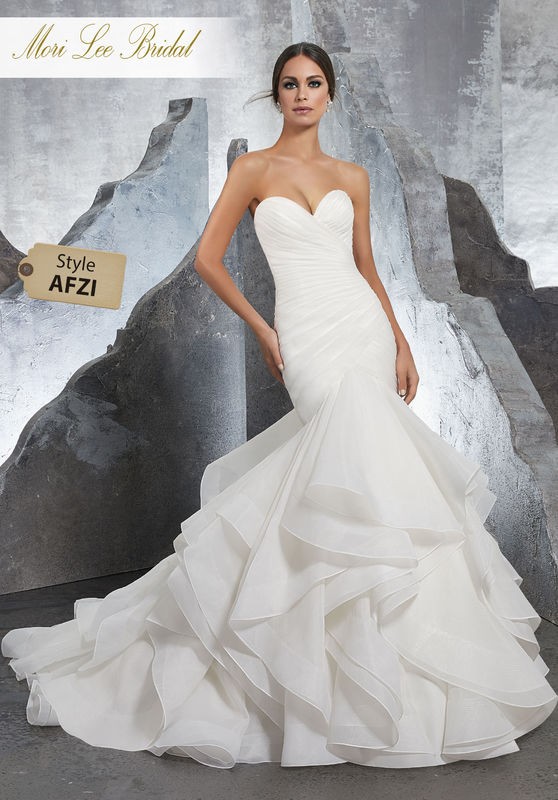 Style AFZI Karina Wedding Dress  Form Fitting Sateen Organza Mermaid with Flounced Full Skirt Trimmed in Horsehair. Covered Buttons Along the Back Complete the Look. Available in Three Lengths: 55″, 58″, 61″. Colors Available: White, Ivory, Ivory/Stripe
