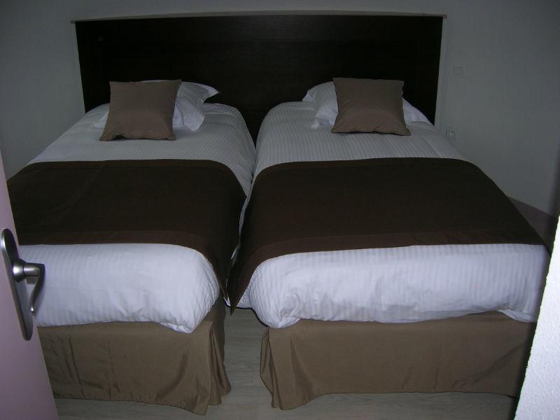 chambre quadruple avec 2 lits dans la tour photo n°1