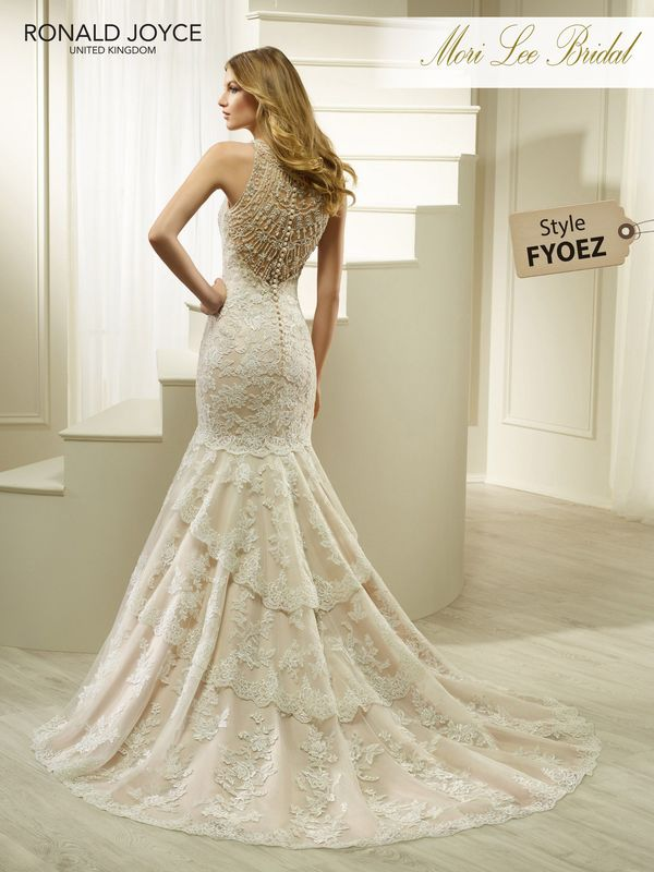 Style FYOEZ HAPPY  AN ORGANZA AND SATIN FISHTAIL DRESS WITH LACE APPLIQUES, EXQUISITE BEADED TULLE BACK DETAIL AND TIERED TRAIN. PICTURED IN ALMOND/IVORY.  AVAILABLE IN 3 LENGTHS: 55', 58' AND 61'   COLOURS IVORY, ALMOND/IVORY