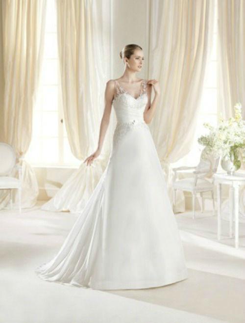 Beispiel: Brautkleid von La Sposa, Foto: PETRA PABST Braut- und Abendmode.