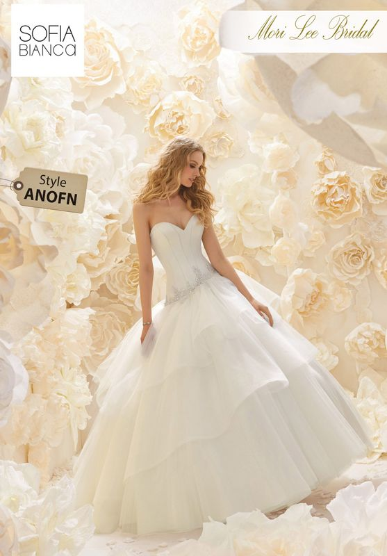 Style ANOFN STRAPLESS BONED SATIN CORSET ON A LAYERED TULLE SKIRT WITH BEADED APPLIQUES    COLOURS WHITE OR IVORY