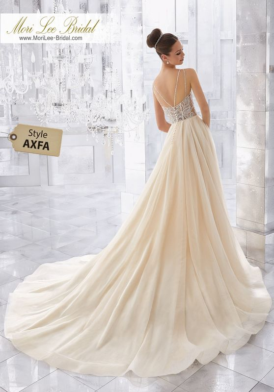 Style AXFA Misty Wedding Dress  Soft and Ethereal, This Silky Net Soft Ball Gown Features a Dazzling Crystal and Diamanté Beaded Sheer Bodice with Exposed Boning. Delicate Double Back Straps Complete the Look. Matching Satin Bodice Lining Included. Colors Available: White/Silver, Ivory/Silver,Ivory/Champagne