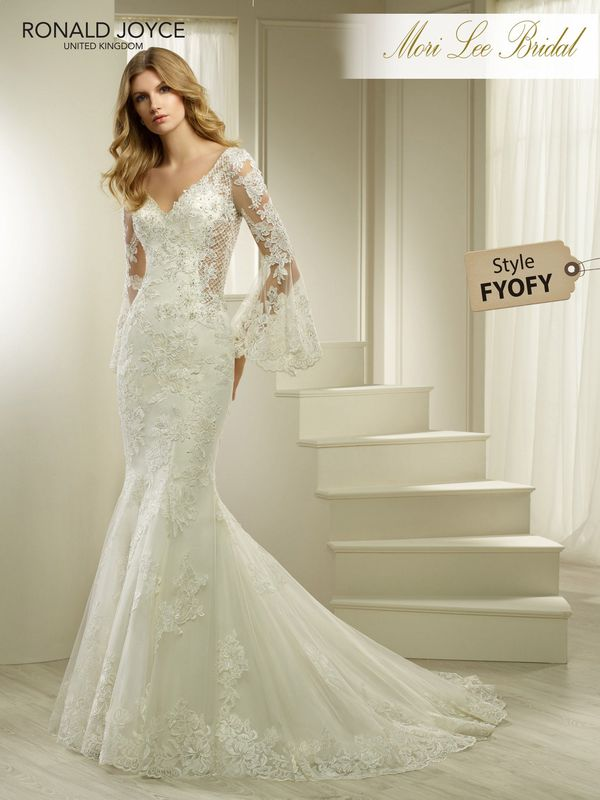 Style FYOFY HUDSON  A SATIN AND ORGANZA FISHTAIL DRESS WITH LACE APPLIQUES, UNIQUE ILLUSION PANELS AND BELL SLEEVES. DRESS COMES WITH A REMOVABLE BODICE LINING – NOT PHOTOGRAPHED. PICTURED IN IVORY.  AVAILABLE IN 3 LENGTHS: 55', 58' AND 61'   COLOURS WHITE, IVORY