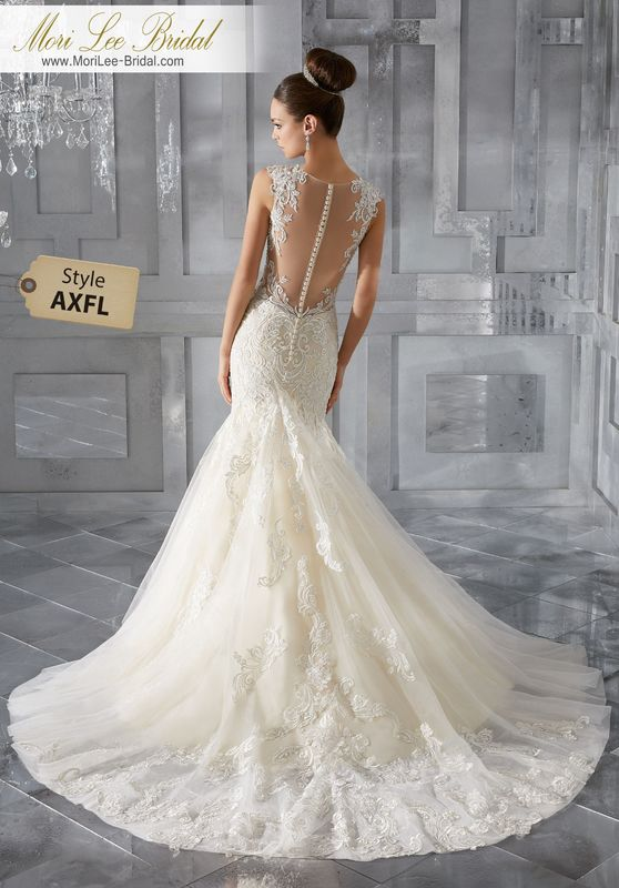 Style AXFL Monika Wedding Dress  This Glamorous Soft Tulle Fit and Flare Wedding Gown Features Diamanté Beaded, Sculptured Lace Appliqués and a Stunning Illusion Back with Covered Button Detail. Colors Available: White, Ivory, Ivory/Light Gold.