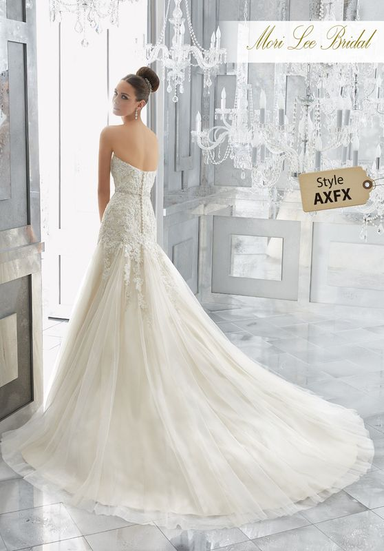 Style AXFX Maura Wedding Dress  A Classically Elegant Fit and Flare Wedding Gown Comes to Life with Crystal Beaded Alençon Lace Appliqués and Gored Tulle Skirt. A Removable Beaded Organza Belt, Also Sold Separately as Style NXOFA, Completes the Look. Colors Available: White/Silver, Ivory/Silver,Ivory/Light Gold Silver.