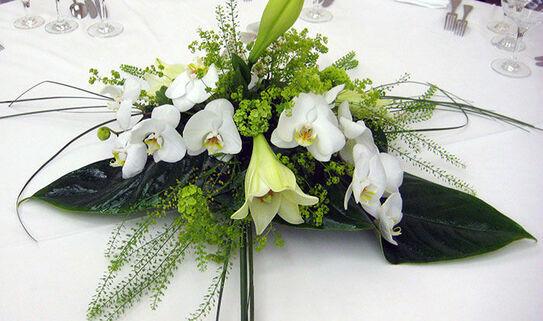 Beispiel: Tischgesteck, Foto: Blumen-Heidi - Die Floristen-Werkstatt.