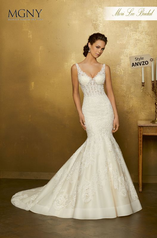 Style ANVZO Orphea  Frosted, re-embroidered lace appliqués on a tulle mermaid  Detachable tulle train  Matching satin bodice lining included