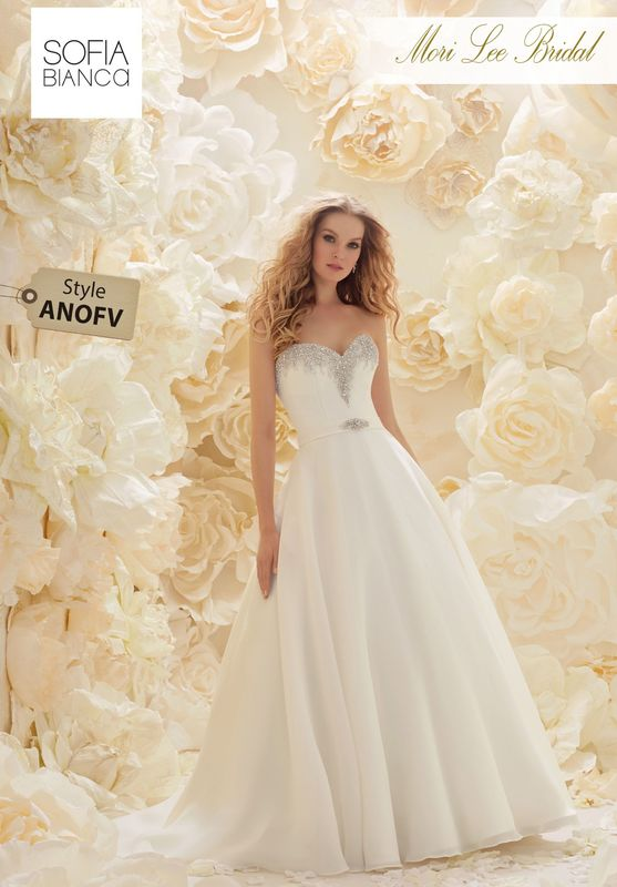 Style ANOFV A STRAPLESS TEXTURED ORGANZA DESIGN WITH A CRYSTAL BEADED NECKLINE AND MATCHING WAISTBAND  COLOURS IVORY / SILVER