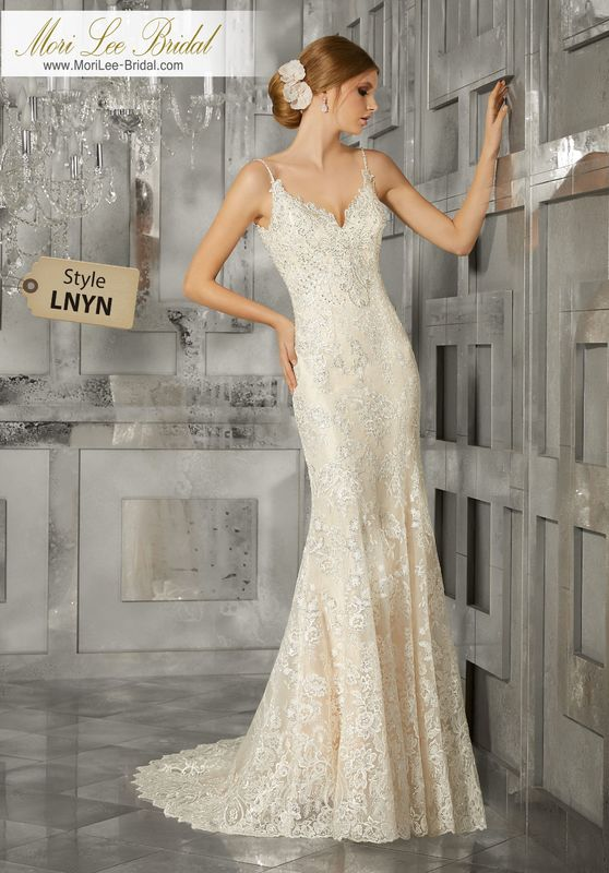 Style LNYN Merlada Wedding Dress  Diamanté Beaded Embroidered Lace Appliqués Take Center Stage on This Romantic Soft Fit and Flare Wedding Dress. A Wide Scalloped Hemline and Plunging Back Complete the Look. Available in Three Lengths: 55″, 58″, 61″. Colors Available: White/Silver, Ivory/Silver,Ivory/Light Gold Silver.