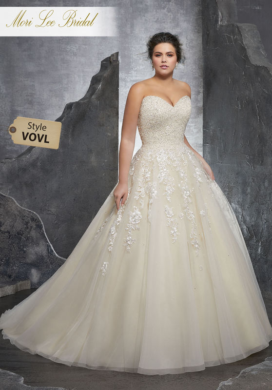 Style VOVL Kasmira Wedding Dress  Princess Perfect, This Beautiful Tulle Ball Gown Features a Crystallized Beaded Sweetheart Bodice with Embroidered Appliqués. A Corset Style Back Completes the Look. Colors Available: White, Ivory, Ivory/Champagne