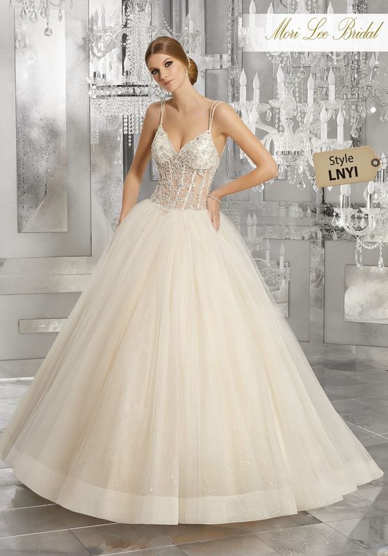 Style LNYI Midori Wedding Dress  Fit For a Queen, This Dreamy Bridal Ballgown Features a Crystal Beaded Embroidered Bodice on a Full Tulle Skirt Over Sequined Net. Sheer Bodice with Exposed Boning and Delicate Double Back Straps Complete the Look. Matching Satin Bodice Lining Included. Available in Three Lengths: 55″, 58″, 61″. Colors Available: White/Silver, Ivory/Silver,Ivory/Light Gold Silver.