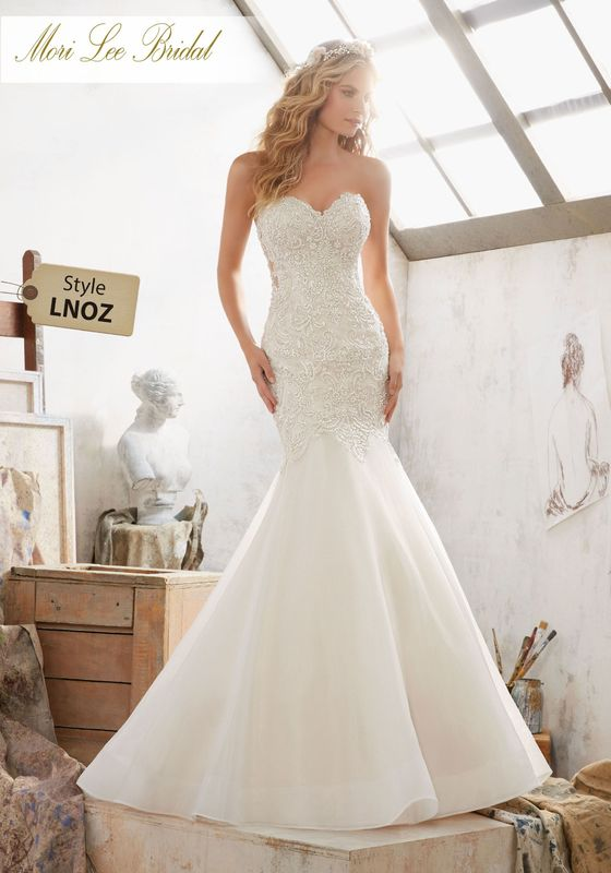 Dress style LNOZ Margot Wedding Dress Colors Available: White, Ivory, Ivory/Champagne. Shown in Ivory/Champagne.