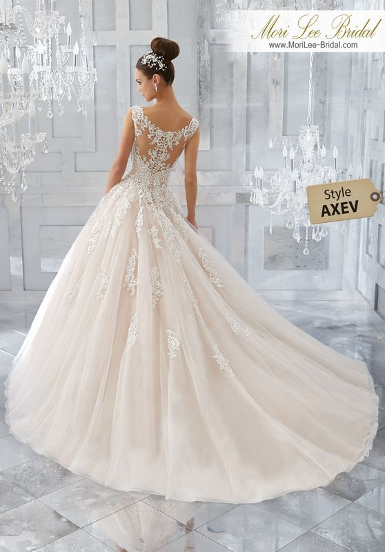 Style AXEV Massima Wedding Dress  A Fairytale Ballgown is Brought to Life with Crystal Beaded, Embroidered Lace Appliqués and a Full Tulle Skirt. An Elegant Off-the-Shoulder Neckline and Intricate Illusion Back Complete the Look. Colors Available: White, Ivory, Ivory/Light Gold,Ivory/Blush.