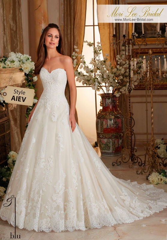 Dress Style AIEV  CHANTILLY AND EMBROIDERED LACE ON TULLE BALL GOWN WITH SCALLOPED HEMLINE  Available in Three Lengths: 55