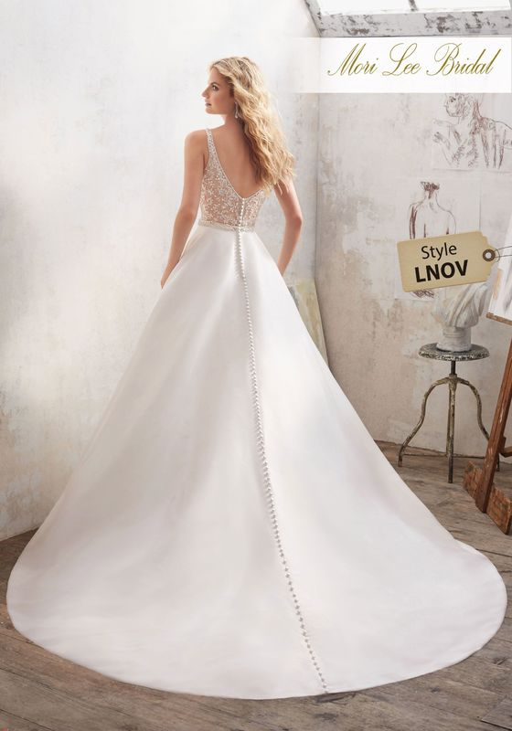 Dress style LNOV Maribella Wedding Dress Available in White/Silver, Ivory/Silver. Shown in Ivory/Silver.