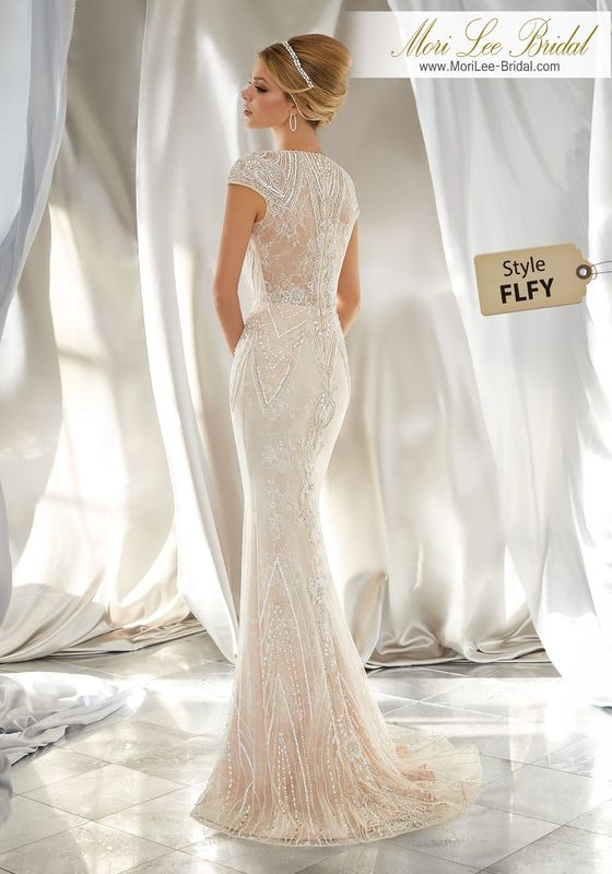 Style FLFY Musidora Wedding Dress  Intricate Beadwork Creates a Glamorous Look on This Slim, Tulle Gown Over Chantilly Lace. A High Neckline and Cap Sleeves Complete the Look. Colors Available: Ivory|Nude.