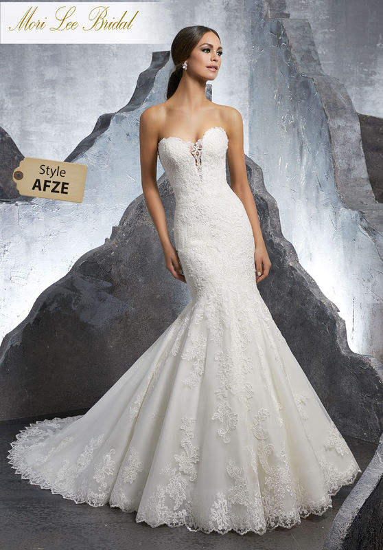 Style AFZE Kaitlyn Wedding Dress  Romantic Frosted, Alençon Lace Mermaid Net Wedding Dress Accented in Appliqués and a Delicate Scalloped Hemline. An Exposed Boned Back Trimed in Covered Buttons Completes the Look. Available in Three Lengths: 55″, 58″, 61″. Colors Available: White, Ivory