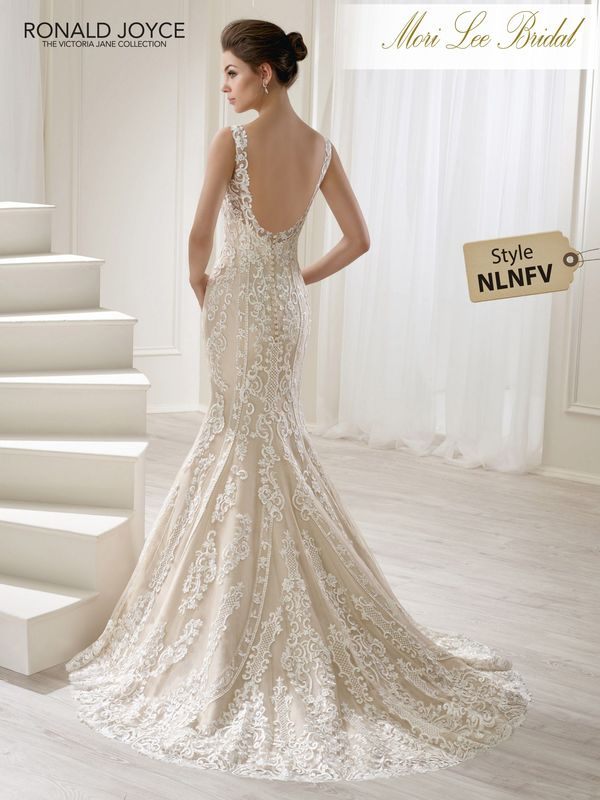 Style NLNFV LEONELA A TULLE AND SATIN FISHTAIL DRESS WITH AN ALL-OVER LACE PATTERN, V-NECKLINE AND OPEN BACK. PICTURED IN LIGHT GOLD/IVORY.  AVAILABLE IN 3 LENGTHS: 55', 58' AND 61'   COLOURS IVORY, LIGHT GOLD/IVORY