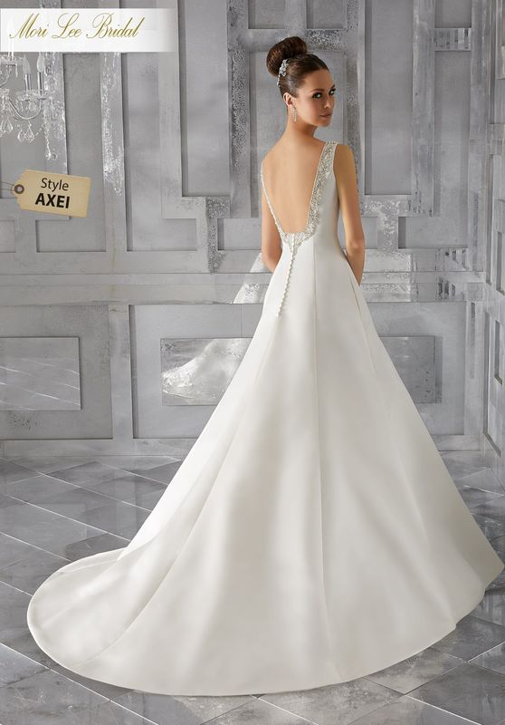 Style AXEI Malke Wedding Dress  Simple and Elegant, This Duchess Satin A-Line Bridal Gown Features Diamanté Beaded Embroidery Along the Shoulders and Down the Open Back. Colors Available: White/Silver , Ivory/Silver.