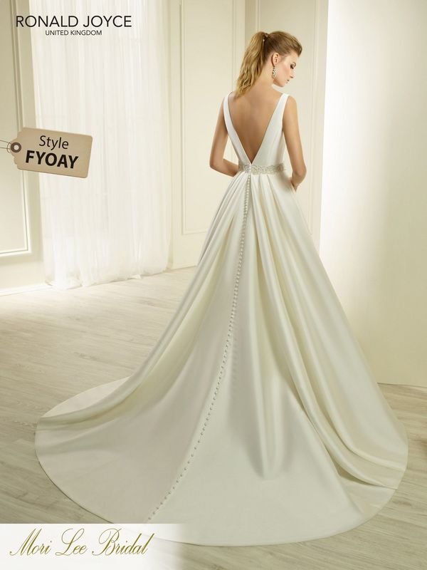 Style FYOAY HYACINTH  A SLEEVELESS MIKADO A-LINE DRESS WITH A UNIQUE NARROW CUT OUT NECKLINE, DEEP V-BACK AND BEADED BELT DETAIL. PICTURED IN IVORY.  COLOURS WHITE, IVORY