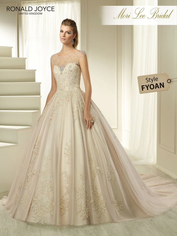 Style FYOAN HANNE  A SATIN AND TULLE BALL GOWN WITH A BEADED ILLUSION NECKLINE, DELICATE LACE APPLIQUES AND PLEATED SKIRT. PICTURED IN LIGHT GOLD/BLUSH. COLOURS WHITE, IVORY, LIGHT GOLD/BLUSH