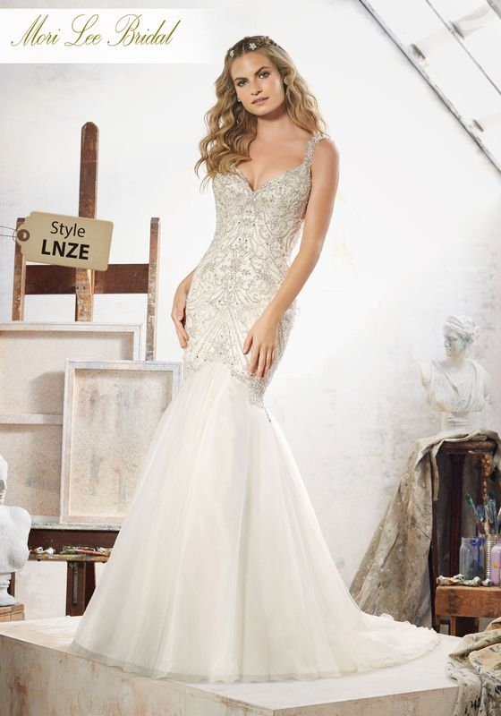 Dress style LNZE Maeve Wedding Dress Colors Available: White/Silver, Ivory/Silver, Light Gold/Silver. Shown in Light Gold/Silver.