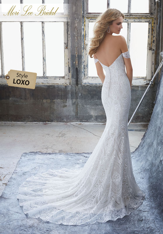 Style LOXO Karissa Wedding Dress  Glamorous Sheath Featuring Deco Inspired Frosted Embroidery on Net. A Deep Sweetheart Neckline and Off-the-Shoulder Cap Sleeves Complete the Look. Colors Available: White, Ivory, Ivory/Light Nude